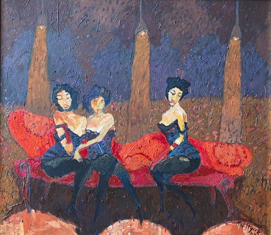 Obraz kobiet siedzących na czerwonej sofie